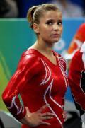 图文-中国体操首夺奥运女团冠军 萨克拉莫妮看成绩