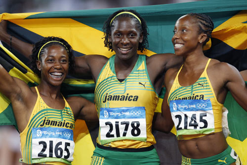 图文-女子100米牙买加选手夺金 同庆激动时刻