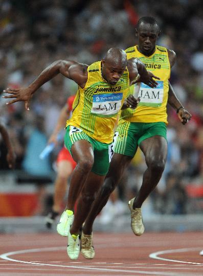 图文-男子4X100米接力牙买加队夺金 鲍威尔接棒