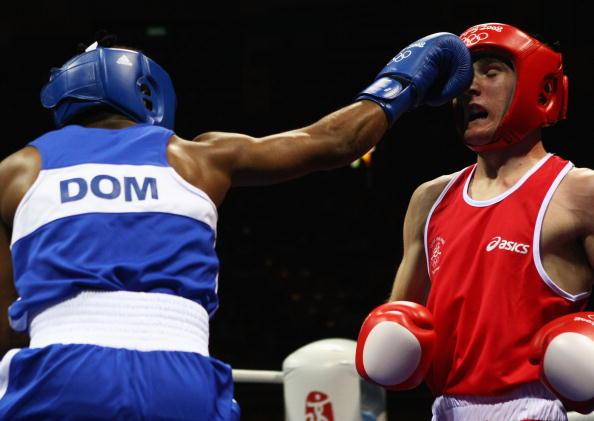 图文-14日奥运会拳击比赛赛况 这一拳打个正着
