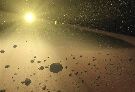 在小行星表面发现水冰也令科学家感到很奇怪,因为它们本应迅速蒸发掉。这表明小行星(如这幅艺术构想图所示)将生命带到了地球。