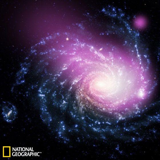 这张照片展示的是一个距离地球约6000万光年的遥远星系图像,由美国宇航局钱德拉X射线空间望远镜获得的X射线数据,以及欧洲南方天文台甚大望远镜拍摄的该星系可见光数据合成而来。图像中可以察觉出这个星系与一个邻近矮星系之间发生过一次撞击事件的线索