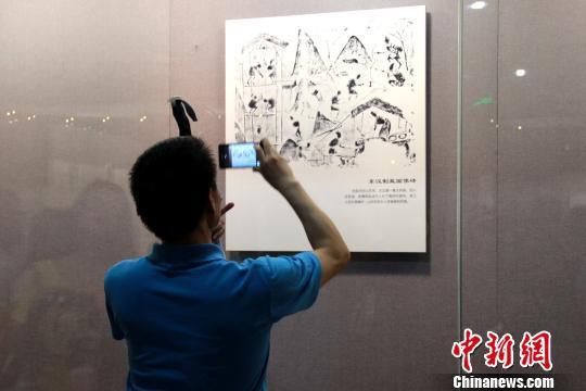 37件汉墓画像砖亮相东汉人煮盐或用天然气(图)