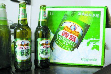 """买""""青岛啤酒""""    买到""""假青岛""""   天气渐热,啤酒消费也渐成市民饭桌"""