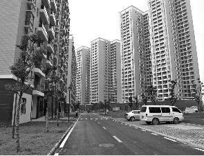武汉房产公司未经环评在重污染土地建起经适房