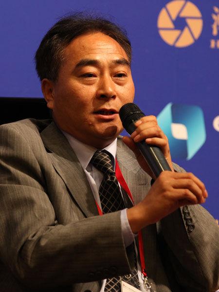 """""""2013中国金融论坛""""于2013年5月21日-23日在北京召开。上图为东京证券北京代表处首席代表逯家�_。(图片来源:新浪财经)"""
