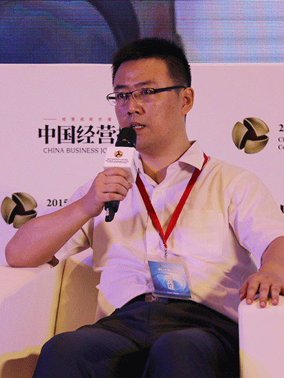 上图为北京汽车集团产业投资有限公司副总裁陈卓。(图片来源:新浪财经 顾国爱 摄)