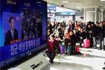 韩国民众看金正日逝世报道