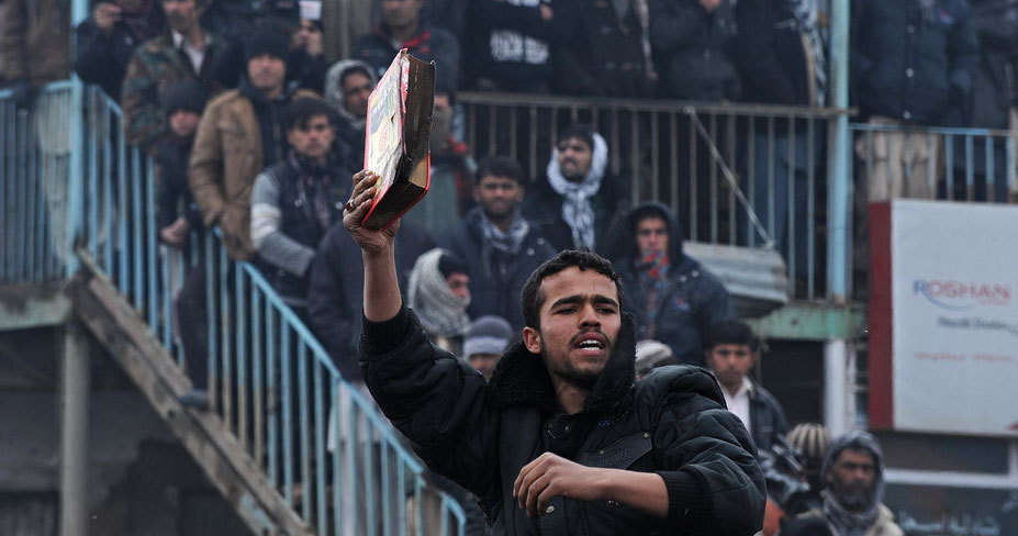 Afghans protest Koran burning at U.S. base
