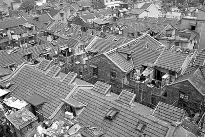上海市人大建议剥离部分与户籍挂钩福利
