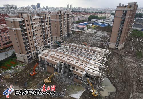 上海倒楼小区九成业主选定赔付方案多数不退房