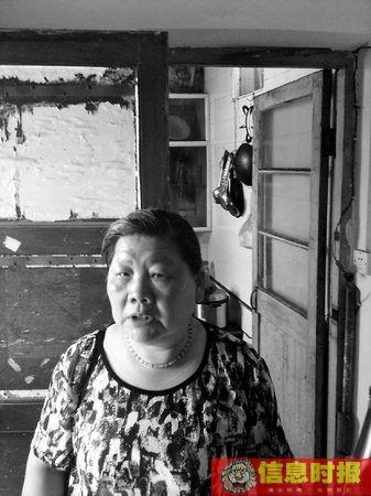邻居冷阿姨谈徐武。专题撰摄影 信息时报记者 闫晓光