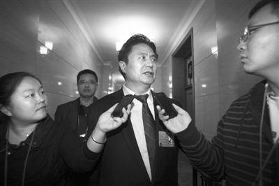 昨日,北京,海南代表团对记者开放,海南省委书记罗保铭接受采访。本报记者 吴江 摄