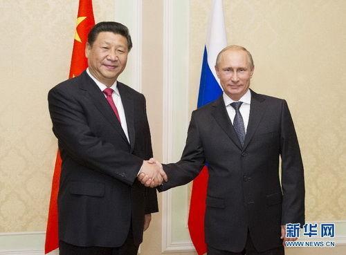 2014年9月11日,国家主席习近平在杜尚别会见俄罗斯总统普京。