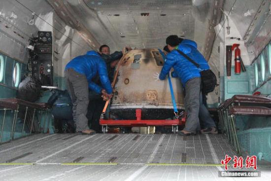 中国第一次完成了绕月飞行器的回收任务