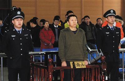 2014年12月19日,伊春区法院,齐全军出庭。当日,齐全军获刑三年。新华社记者 梁书斌 摄