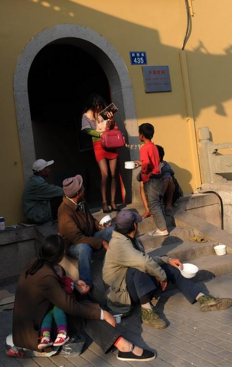 市民走出庙门被小乞丐拦住-罗帅 的空间 百度空间图片