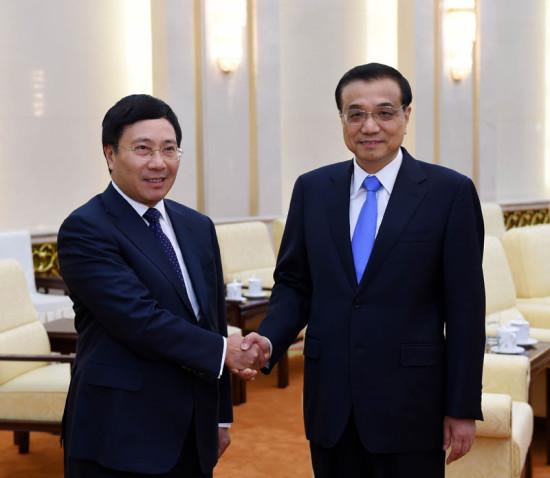李克强会见越南副总理范平明