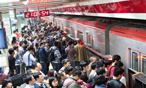 """在连一些高福利国家的地铁都大多""""按站收费""""时,北京地铁""""几乎白坐""""的情况显然难以为继"""