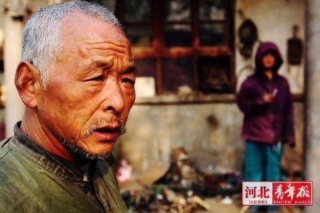 """杨军平说:""""我不怕死,但怕这两个孩子没人照顾。"""