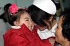 地震伤残女童出院