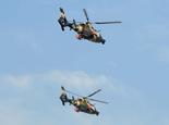 国产最新型武装直升机受阅机群加紧演练