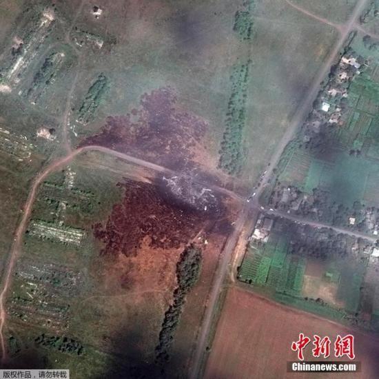 资料图 :2014年7月20日,数字地球当天提供的资料卫星图显示,马航MH17航班在乌克兰坠毁地点景象。