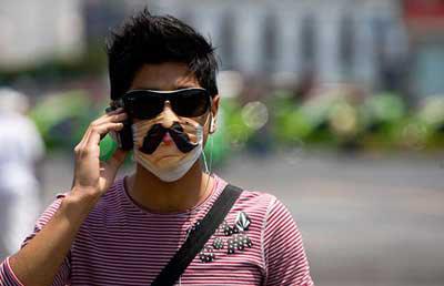 猪流感笼罩下的快乐生活:墨西哥人的幽默(组图)
