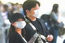 台湾机场人们戴口罩候机