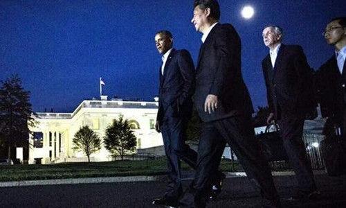 月圆之夜,习近平同奥巴马举行会谈。