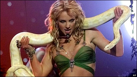 Britney Spears performing with a snake