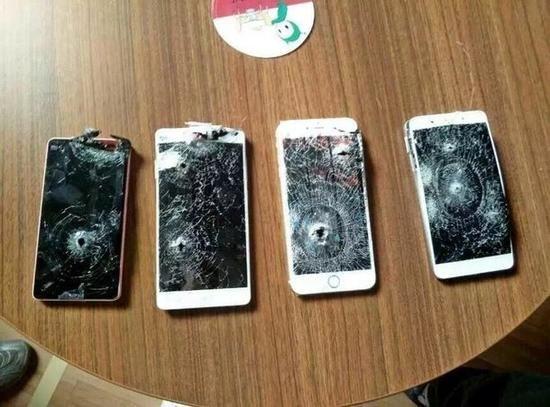 周鸿�t卖手机也是拼了:箭射苹果小米奇酷比硬度