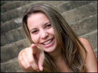 A girl laughing and pointing
