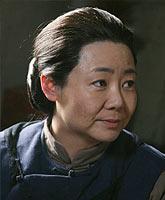 萨日娜饰关小脚