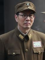 姚 刚饰演贺国光