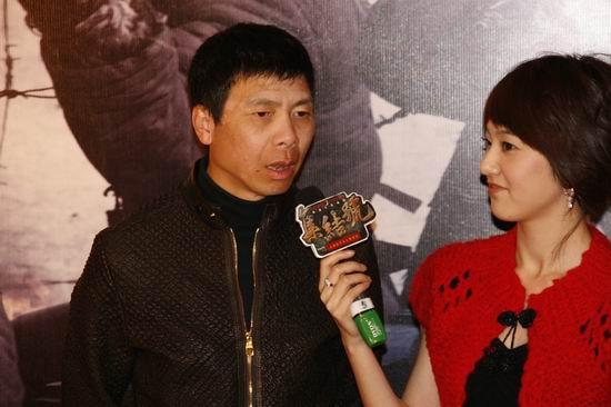 图文:《集结号》主题馆开幕冯小刚对话主持人