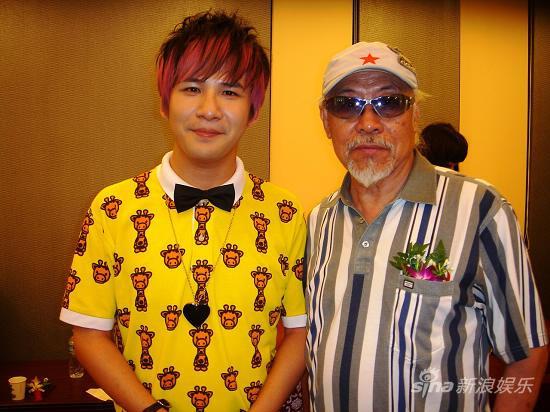 大张伟与萨克斯表演艺术家范圣琦合影-大张伟献唱 青少年艺术教育精