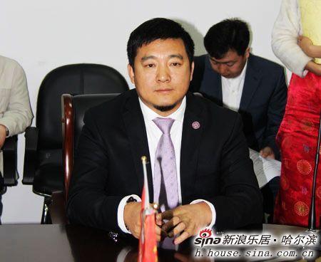 图为哈尔滨龙运汽配物流管理有限责任公司董事长满国金先生