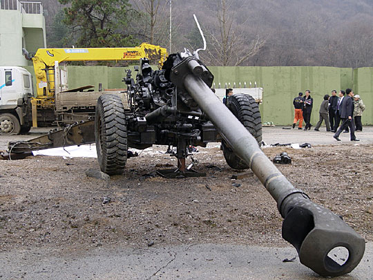 trailer will be towed away by the explosion of 155-mm howitzer.
