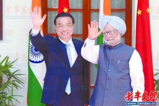 5月20日,国务院总理李克强在新德里与印度总理辛格举行会谈。新华社发