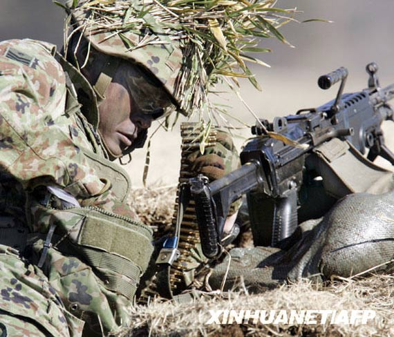 1 月 11 日, airborne troops in combat machine gunner. Xinhua News Agency/Agence France