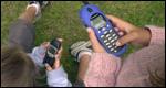 children using mobiles