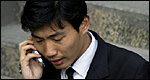 Man in suit talking on mobile phone