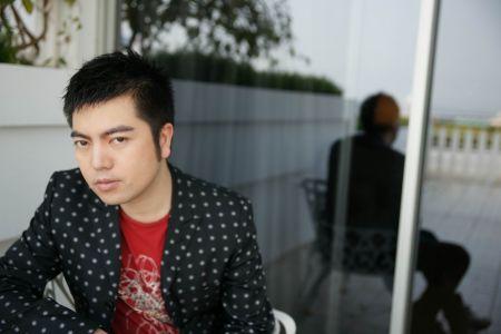祁刚:中国十大服装设计师图片