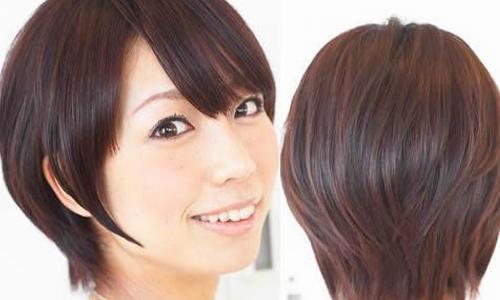 红色的挑染增添了整体发型的华丽感,短发也很有女人味.