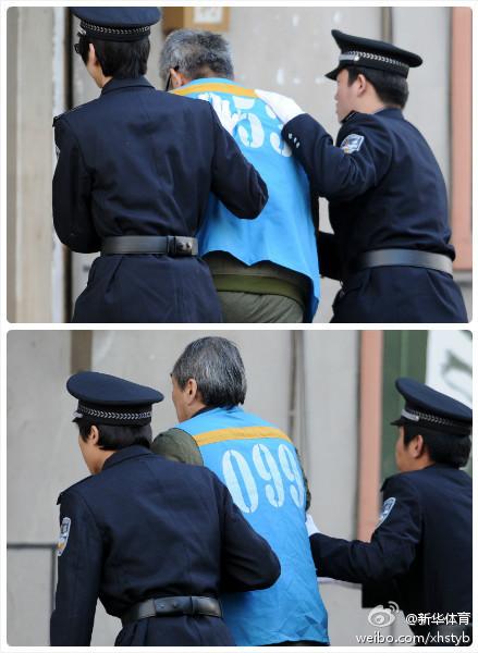 杨一民张建强被押入法庭