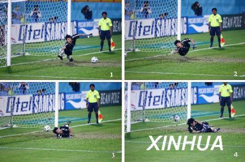 王大雷在多哈亚运会上扑点球,球击中后背弹入球门。