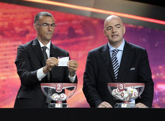 贝尔戈米(左)看好国米