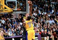 NBA老照片-五年光阴转瞬即逝青涩姚明从不惧科比