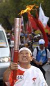 图文-北京奥运圣火在曼谷传递 火炬手齐姆在传递中